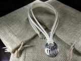 Медальон Медвежья лапа #3 на замшевых шнурах 002 Молочный